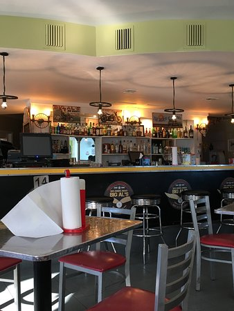 Big Al's Island Burger: interior of restaurant - bar area and diner style seating, AC