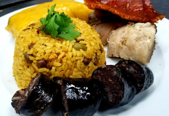 Traditional Christmas Puerto Rican Dish Pork Rice With Pigeon