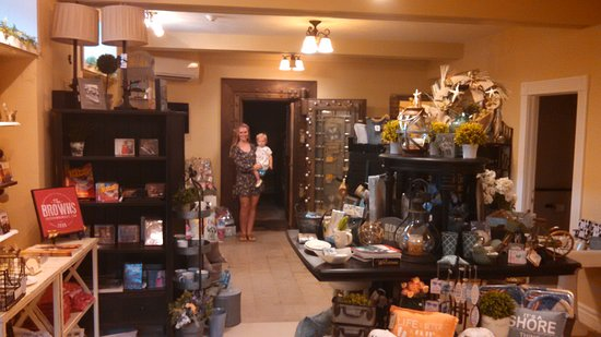 Le Mars, IA: Jen, Adam Brown's lovely wife, & Kate, their little girl standing in front of the gift shop vaul