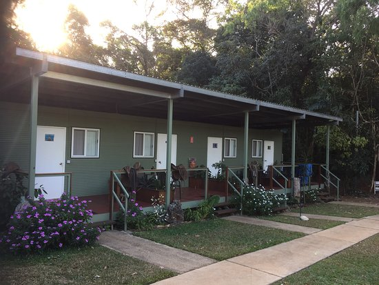 Lockhart, Australia: Row of en suite cabins, showing private verandahs with table and chairs.