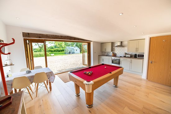 The indoor kitchen and pool table - Picture of Tin Can ...
