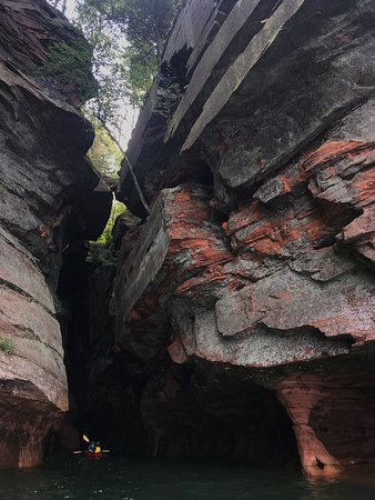 Apostle Islands Kayak Tours: We were able to paddle right into the larger caves, where it was cool and dark...