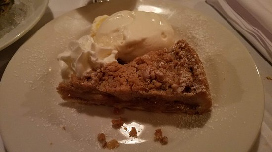 Queens Village, NY: All smiles now...who doesn't like some apple crumb cake with melted vanilla ice cream?