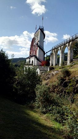 The Laxey Wheel with pipe carrying water along it to the Tower
