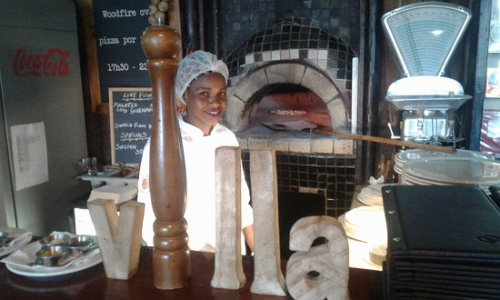 Vredehoek, Sør-Afrika: Our Foccacia is baking in the Wood fired oven, handmade by Joyce.
