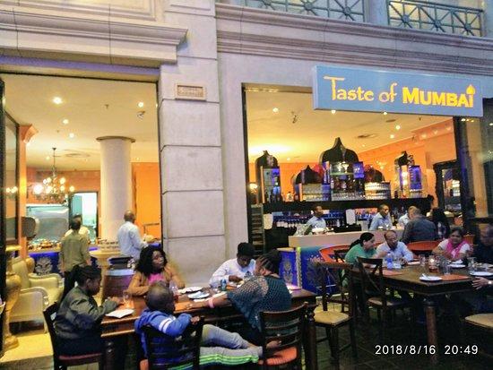 "Gauteng, Sudáfrica: Taste Of Mumbai. Seating in pain Plaza, Under ""Blue Sky"""