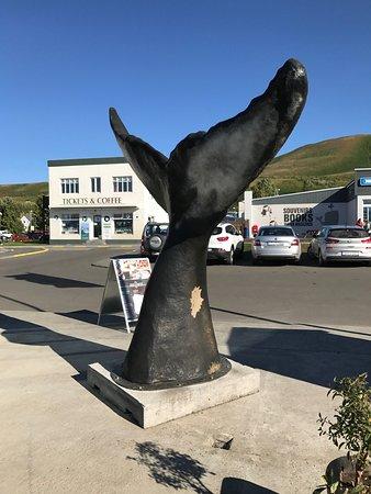 Husavikurkirkja: Gentle Giants whale tail across from church.