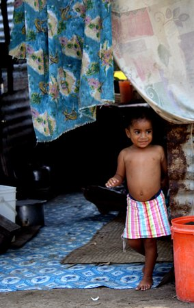 Fiyi: Visiting the local villages in Fiji where we met incredible people and made friends with this little girl.