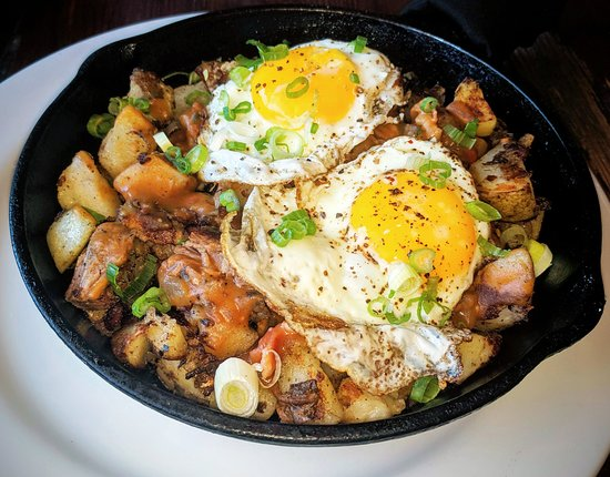 Lou's Full-Serv: Beef brisket hash with potatoes, spring onions and sunny side up eggs. Finger licking delicious!