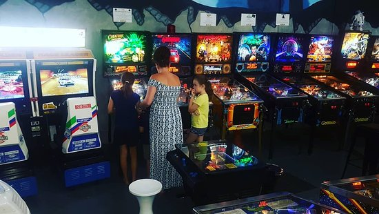 Mum amd the kids haning out at the Noosaville pinball arcade