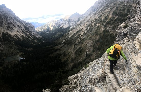Crypt Lake Trail: Ledge walk, headed down, holding safety cable (thrilling but not terrifying!)