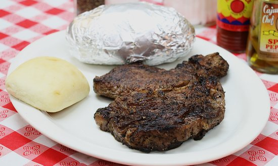 Wiggins, MS: Ribeye Steak (available after 5pm) Baked Potato and a Dinner Roll