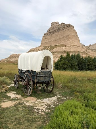 Covered wagon with bluff in the background