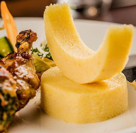 Nairobi Region, Kenya: Our Stuffed Chicken Breast, served on a bed of vegetables, with gratinated polenta