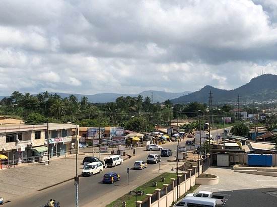 Koforidua, Ghana: View from hotel room to CBD by day.