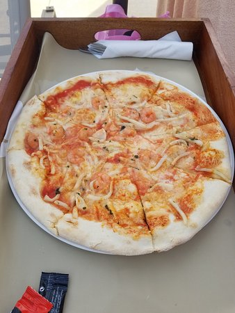 Seafood pizza at the pool