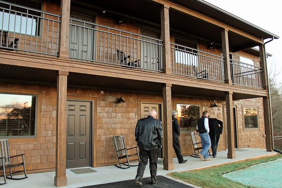The Lodges at Brushy Mountain: 10-room lodge with rocking chairs outside each room