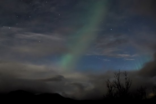 Northern lights through the clouds