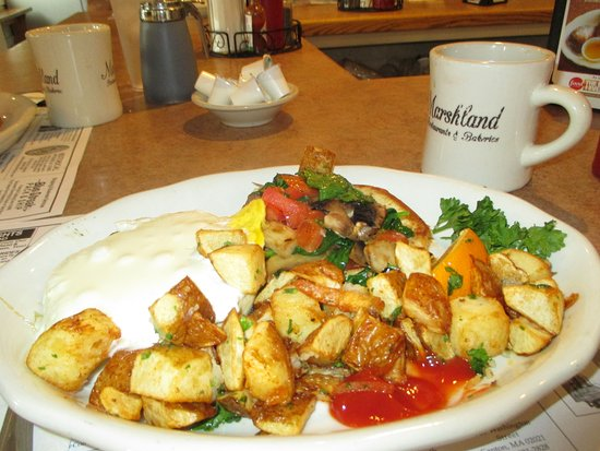 Marshland Restaurants & Bakeries: Poppy Bagel McNagle and home fries - hearty and good