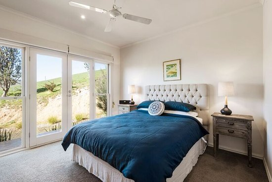 Master Bedroom with French doors to balcony. - Picture of ...