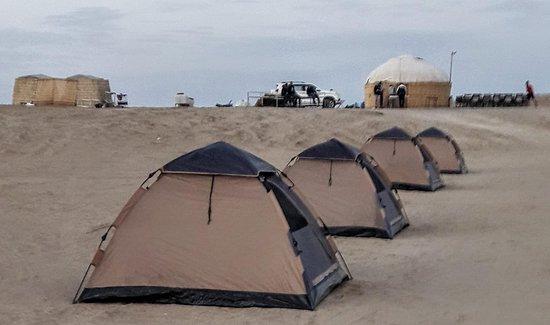 Halkara Dostluk: Dining yurt with tables.