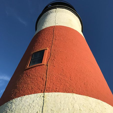 Siasconset, MA: Sankaty Head Lighthouse showing current   Position  and its former location nearer to the cliff