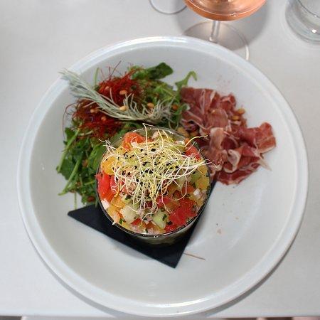 Delicious Salad with penne pasta, tomato tartare, feta and jamon.