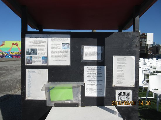 185 Empty White Chairs - Earthquake Memorial: Message board at the memorial