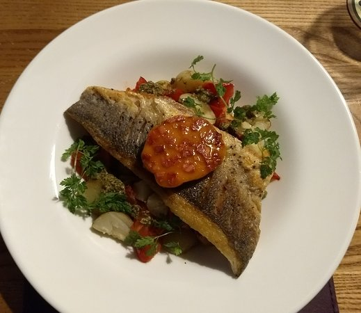 Tadcaster, UK: On the 'specials' board'. Fillet of seabass, sauteed potatoes, tomatoes, peppers, chorizo & pest