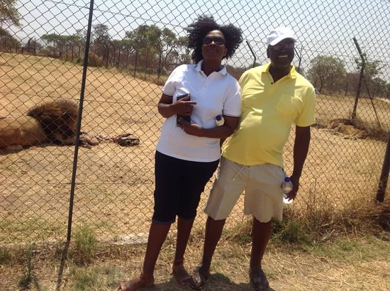 Gweru, Zimbabwe: Posing for a picture after experiencing a lion feeding activity