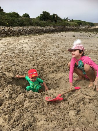 Gwithian Beach: Is this hole deep enough for Granny now😀? Fun time on the beach.