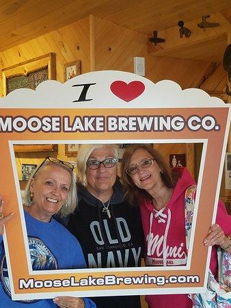 Friends enjoying the Moose Lake Brewing Co.