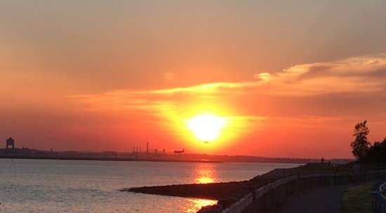 Winthrop, MA: Sunset over Logan Airport to the West