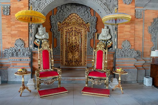 The golden royal chairs where they welcome you upon arrival.