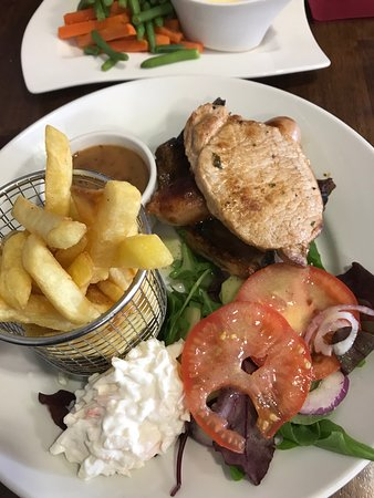 Thomas browns: Pork chop, ribs and port sausage, pepper sauce, chips and side salad