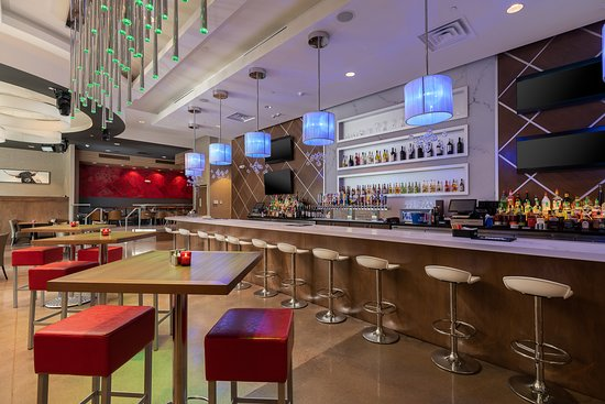 A full-service bar area with over 20 beers on tap featuring domestic ...