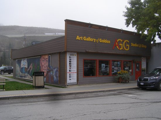 The exterior of the Art Gallery of Golden with a mural along the side of the building.
