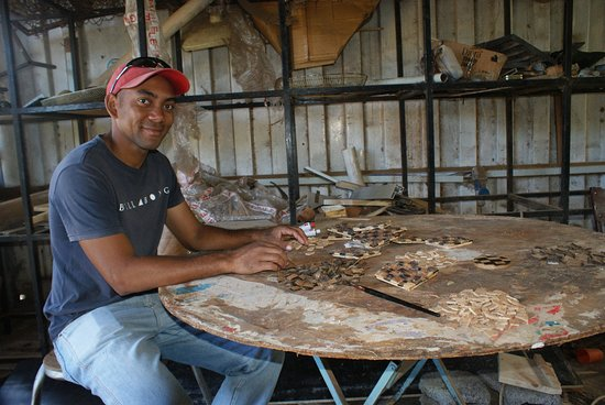 Port Mathurin: Some of the workers crafting coconut shell into decorative pieces.