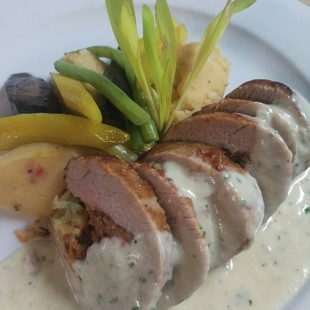 Stuffed Pork Loin with chorizo sausage, leeks and spinach. Topped with herbs creme sauce.