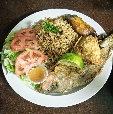 Village 1831 Restaurant: Fry Snapper Dinner w/  Peas n rice , plantain , lettuce & tomato.