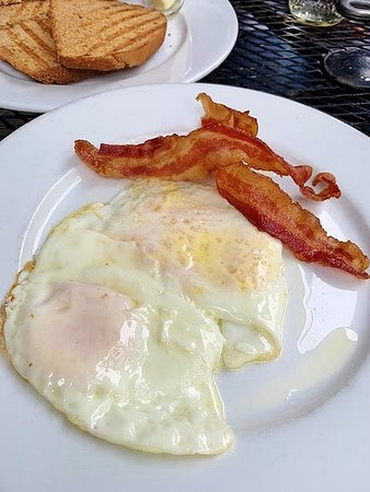 Farm fresh eggs, honey wheat toast and crisp bacon
