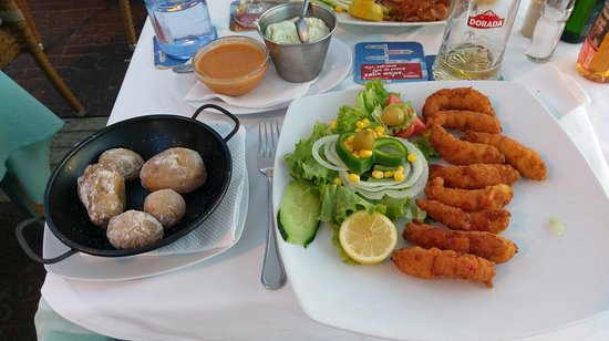La Gran Paella Valenciana: Canarian potatoes (papas arrugadas) and breaded scampi. Red Mojo sauce + aioli mayo