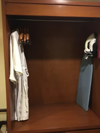 Laurel, Philippines: Closet with bathrobes, iron and board