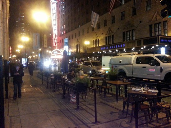 Randolph Tavern Outdoor Dining Along St With The Cadillac Palace Theatre In