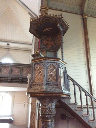 A lovely pulpit decorated like the rest of the interior