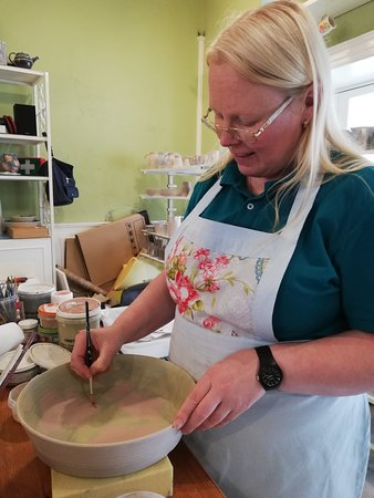 Lillie Ceramics: Jenny painting a dish. Happy to talk about the process - very informative.