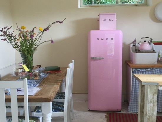 Mayfield, UK: Kitchen in the Hidden cottage.  Big, spotless Smeg fridge!