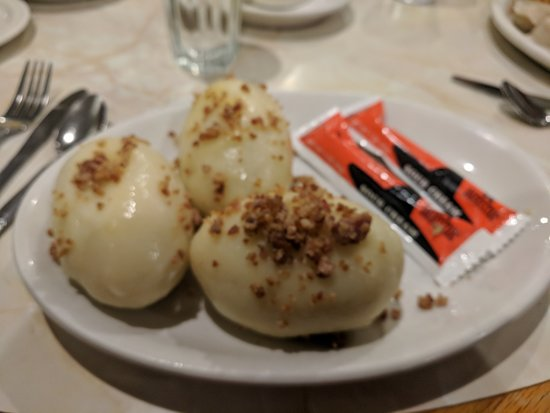 Burbank, IL: This is the Cepelinai. It is a potato dumpling stuffed with ground meat. Sour cream on the side.