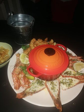 The Deckhouse crab shack: 8 king prawns, sufficient serving of calamari and mussels in pot and 4 lobster tails