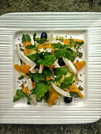 Orange segments rocket and beancurd salad with roasted black sesame and sunflower seeds topped w